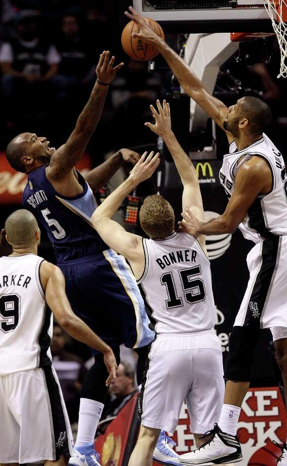 San Antonio Spurs' Tim Duncan blocks a shot by Memphis Grizzlies' Marreese Speights during the second half at the AT&T Center, Wednesday, Jan. 16, 2013. It was one of five blocks shots by Duncan. The Spurs won 103-82. Photo: Jerry Lara, San Antonio Express-News / © 2013 San Antonio Express-News