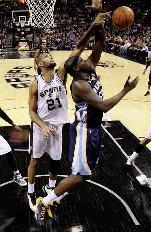 San Antonio Spurs' Tim Duncan blocks a shot by Memphis Grizzlies' Zach Randolph during the second half at the AT&T Center, Wednesday, Jan. 16, 2013. Duncan has five block shots in the game. The Spurs won 103-82. Photo: Jerry Lara, San Antonio Express-News / © 2013 San Antonio Express-News