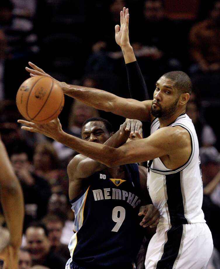 San Antonio Spurs' Tim Duncan goes for a rebound against Memphis Grizzlies' Tony Allen during the first half at the AT&T Center, Wednesday, Jan. 16, 2013. Photo: Jerry Lara, San Antonio Express-News / © 2013 San Antonio Express-News