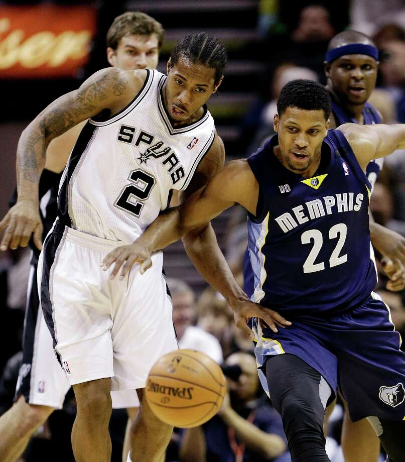 San Antonio Spurs' Kawhi Leonard (2) and Memphis Grizzlies' Rudy Gay (22) battle for a loose ball during the first quarter of an NBA basketball game, Wednesday, Jan. 16, 2013, in San Antonio. Photo: Eric Gay, Associated Press / AP