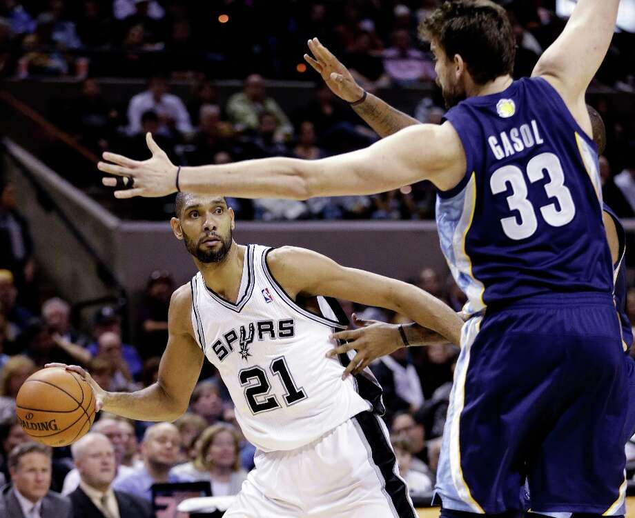 San Antonio Spurs' Tim Duncan (21) looks to pass around Memphis Grizzlies' Marc Gasol (33) during the second quarter of an NBA basketball game, Wednesday, Jan. 16, 2013, in San Antonio. Photo: Eric Gay, Associated Press / AP