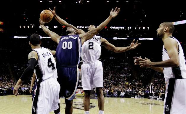 Memphis Grizzlies' Darrell Arthur (00) is blocked by San Antonio Spurs' Kawhi Leonard (2) as Danny Green (4) and Tim Duncan, right, help defend on the play during the second quarter of an NBA basketball game, Wednesday, Jan. 16, 2013, in San Antonio. Photo: Eric Gay, Associated Press / AP