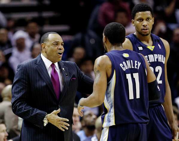 Memphis Grizzlies head coach Lionel Hollins, left, talks with Mike Conley (11) and Rudy Gay, right, during a timeout in the second quarter of an NBA basketball game against the San Antonio Spurs, Wednesday, Jan. 16, 2013, in San Antonio. The Spurs won 103-82. Photo: Eric Gay, Associated Press / AP
