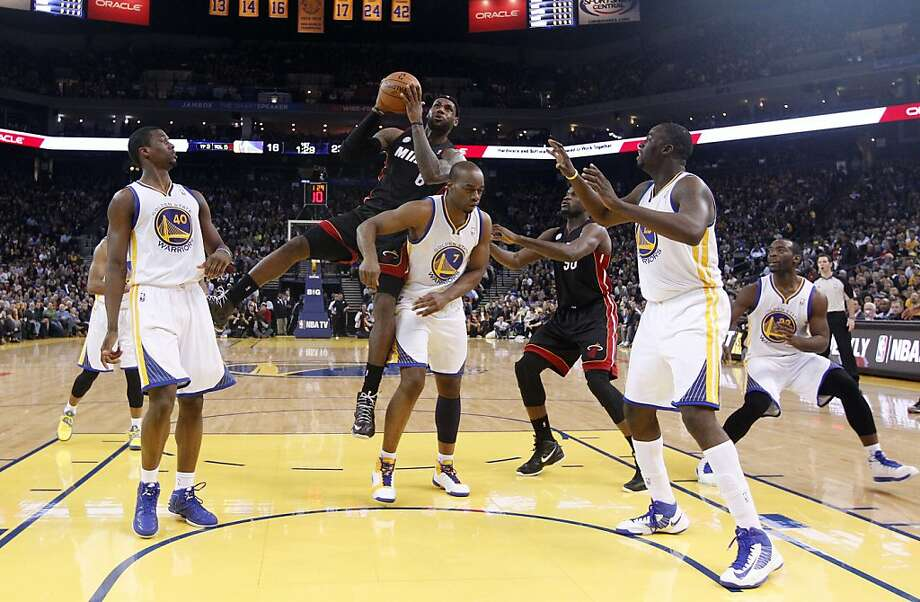Miami Heat's LeBron James (6) goes up for a shot next to Golden State Warriors' Carl Landry (7) during the first half of an NBA basketball game in Oakland, Calif., Wednesday, Jan. 16, 2013. (AP Photo/Marcio Jose Sanchez) Photo: Marcio Jose Sanchez, Associated Press