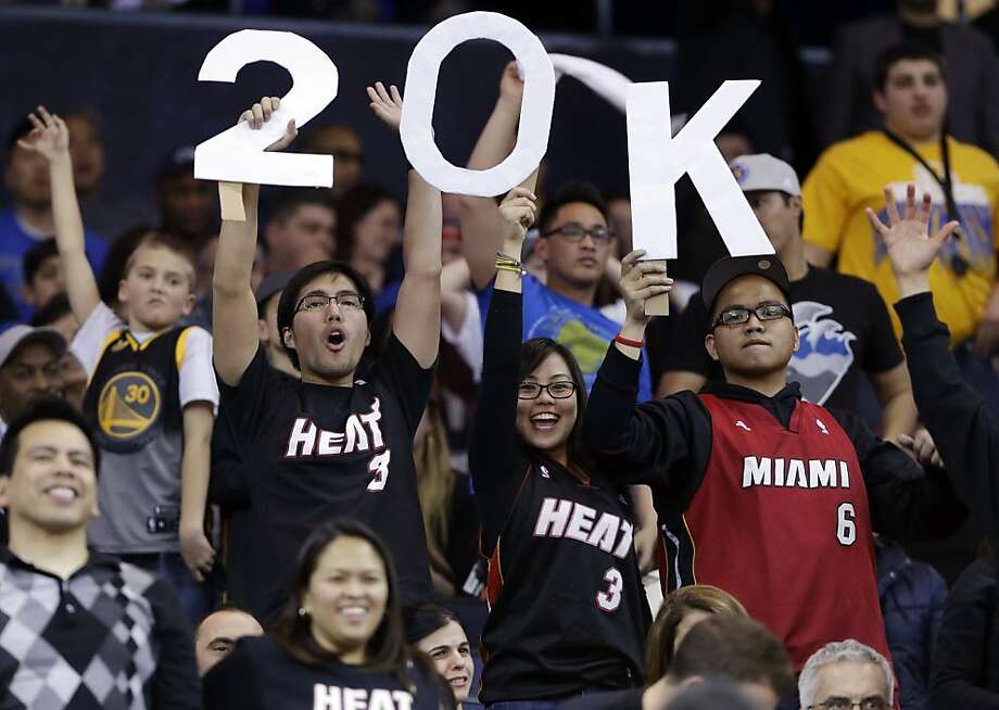 Fans hold up a sign commemorating the Miami Heat's LeBron James' 20,000 career point against the Golden State Warriors during an NBA basketball game in Oakland, Calif., Wednesday, Jan. 16, 2013. James on Wednesday became the youngest player in NBA history to score 20,000 points. (AP Photo/Marcio Jose Sanchez) Photo: Marcio Jose Sanchez, Associated Press