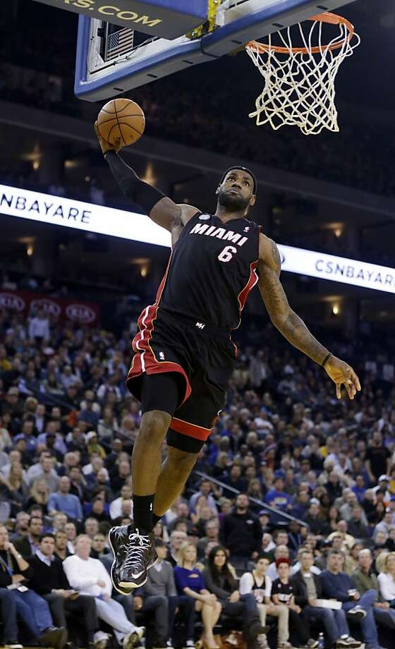 Miami Heat's LeBron James (6) dunks against the Golden State Warriors during the first half of an NBA basketball game in Oakland, Calif., Wednesday, Jan. 16, 2013. James on Wednesday became the youngest player in NBA history to score 20,000 points. (AP Photo/Marcio Jose Sanchez) Photo: Marcio Jose Sanchez, Associated Press