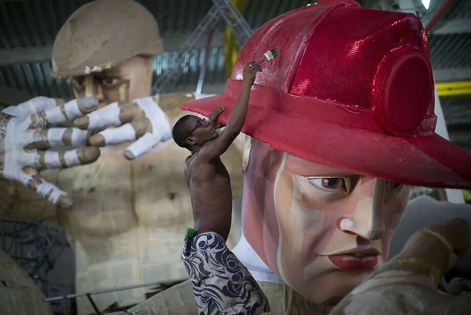 A worker paints a Carnival float sculpture at the Grande Rio Samba school in Rio de Janeiro, Brazil, Wednesday, Jan. 16, 2013. Each year samba schools pick out a theme that may be based on a historic event or a social issue and then bring the idea to life through the use of colorful floats and glamorous costumes, mostly kept under wraps until the start of the pre-Lenten world famous festival,  running this year from Feb. 9-12. Photo: Felipe Dana, Associated Press