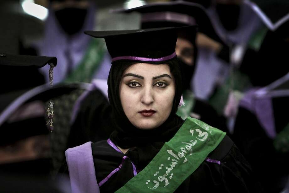 An Afghan midwife attends her graduation ceremony at the governor's house, in Jalalabad east of Kabul, Afghanistan, Wednesday, Jan. 16, 2013. Over 52, midwives graduated after receiving 2 year of training in Jalalabad. Photo: Rahmat Gul, Associated Press