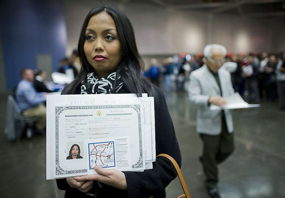 Erliah Winslow, 37, of Rocklin, Calif., and of Indonesia, is among the more then 1,000 new American citizens from nearly 100 countries who were sworn in at the Sacramento Convention Center on Wednesday, Jan. 16, 2013 in Sacramento, Calif. Photo: Renee C. Byer, Associated Press