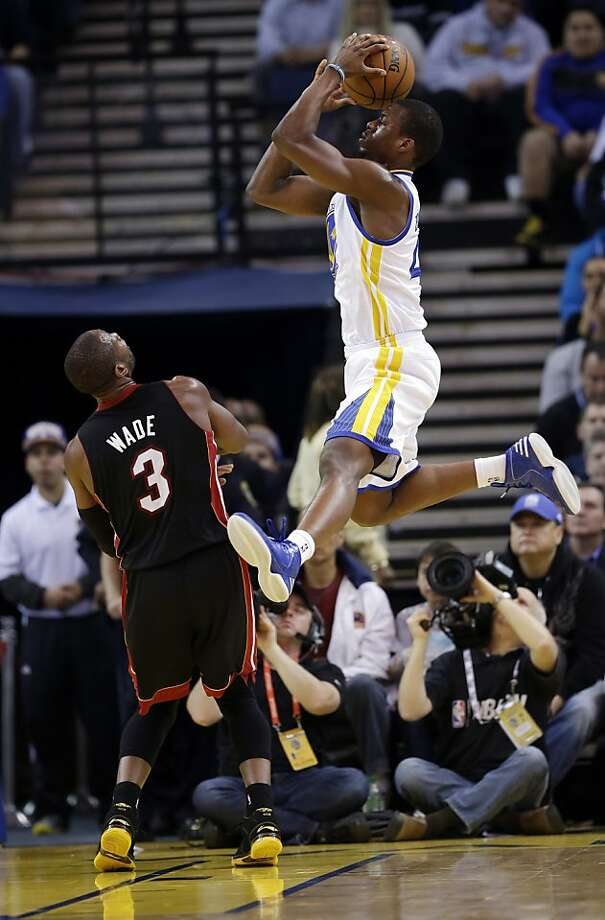 Golden State Warriors' Harrison Barnes, right, shoots over Miami Heat's Dwyane Wade (3)during the first half of an NBA basketball game in Oakland, Calif., Wednesday, Jan. 16, 2013. (AP Photo/Marcio Jose Sanchez) Photo: Marcio Jose Sanchez, Associated Press