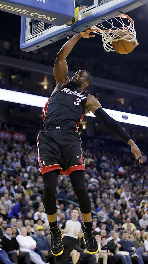 Miami Heat's Dwyane Wade (3) dunks against the Golden State Warriors during the first half of an NBA basketball game in Oakland, Calif., Wednesday, Jan. 16, 2013. (AP Photo/Marcio Jose Sanchez) Photo: Marcio Jose Sanchez, Associated Press