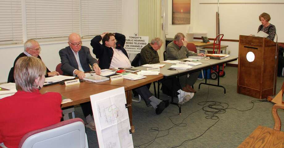 Members of the Conservation Commission on Wednesday listen to a presentation about the proposed Bedford Square project from Karen Johnson, a representative of Bedford Square Associates partnership.  WESTPORT NEWS, CT   1/16/13 Photo: Jarret Liotta / Westport News contributed