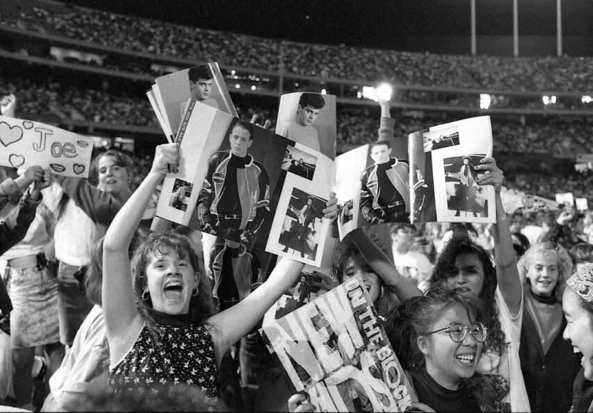 New Kids on the Block fans feel the love during the band's Sept. 8, 1990 show at the Oakland Coliseu