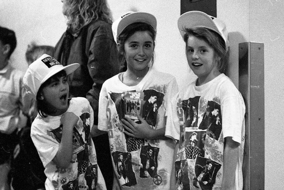 Three young fans at the Dec. 19, 1989 show at the Oakland Coliseum Arena. I'm guessing these might be sisters -- who hopefully appreciate the strain it put on their parents to buy New Kids gear in triplicate. Photo: Vincent Maggiora, The Chronicle / ONLINE_YES
