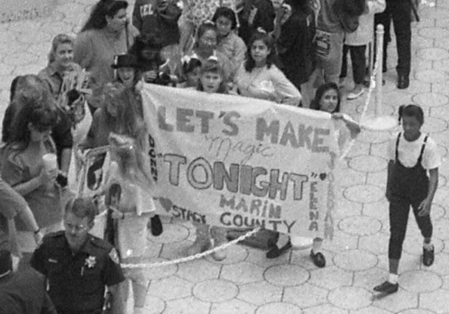 Let's Make Magic Tonight Marin County. With the magic in cursive. This may be my favorite sign in the history of signs. I love how the girls put their name on the bedsheet next to the guy they like. Photo: Steve German, The Chronicle / ONLINE_YES