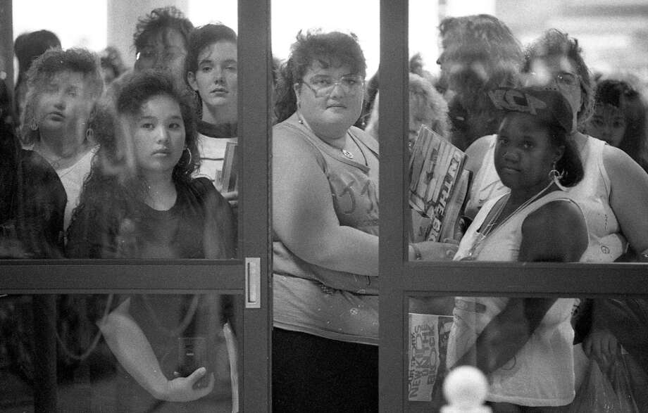 I always assumed the New Kids demo was pretty white, but they attracted a reasonably diverse crowd. These girls seem to be concentrating, in an attempt to will these doors to open. Photo: Steve German, The Chronicle / ONLINE_YES
