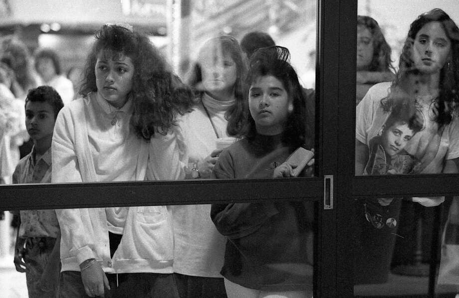 Replace these girls with zombies, and this is a scene from Dawn of the Dead. My favorite part is the little brother tagging along on the left -- someone invent the Game Boy already, so this kid has something to do. Photo: Steve German, The Chronicle / ONLINE_YES