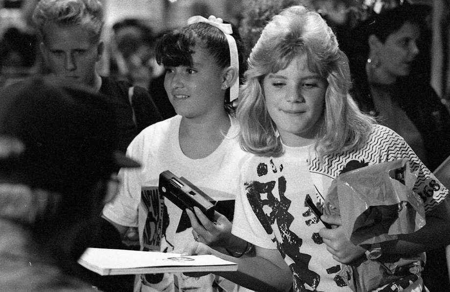 I'm guessing these girls don't miss their 1990s hair. It looks like a ton of effort. Based on the photos, the Hilltop Mall appeared to be only selling New Kids on the Block gear and Kodak Instamatic cameras. Photo: Steve German, The Chronicle / ONLINE_YES