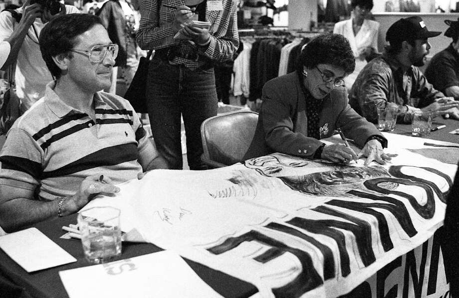 Two of the New Kid parents at Hilltop Mall, signing a truly amazing Donnie bedsheet sign. I am really hoping that 1) The creator of that sign is reading this; and 2) She didn't throw it away. Photo: Steve German, The Chronicle / ONLINE_YES