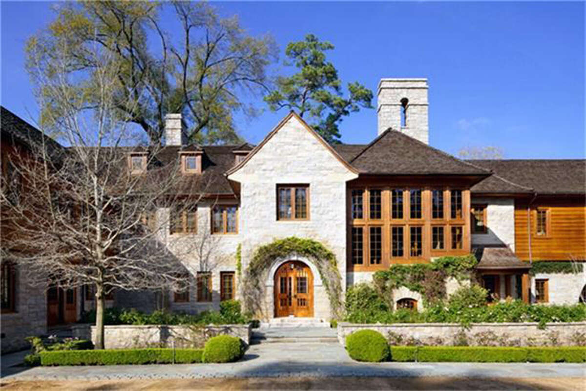 This 16,022 square-foot English country home spans 3.7 acres and was designed by noted Houston architectural firm Curtis & Windham.