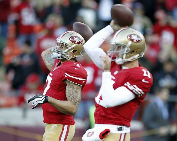 San Francisco 49ers quarterback Colin Kaepernick (7) and quarterback Alex Smith (11) warm up before an NFC divisional playoff NFL football game against the Green Bay Packers in San Francisco, Saturday, Jan. 12, 2013. Photo: Tony Avelar, Associated Press