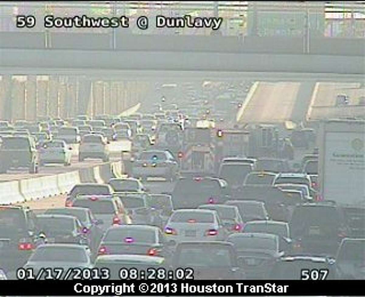 Traffic was snarled on the northbound Southwest Freeway near Mandell after a wreck about 8 a.m. Thursday.