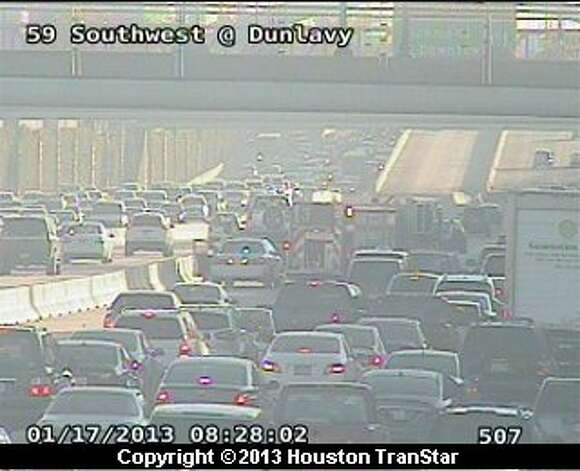Traffic was snarled on the northbound Southwest Freeway near Mandell after a wreck about 8 a.m. Thursday. Photo: Houston Transtar