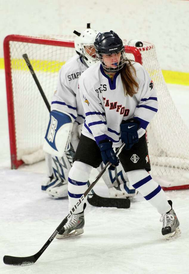 #17 Linsey Furman (Staples high school) Stamford/Westhill/Staples high school girls ice hockey team defends the area in front of her teams goal in a game against Ridgefield high school played at Terry Conners Rink in Stamford, CT on Wednesday January 16th, 2013. Photo: Mark Conrad / Stamford Advocate Freelance
