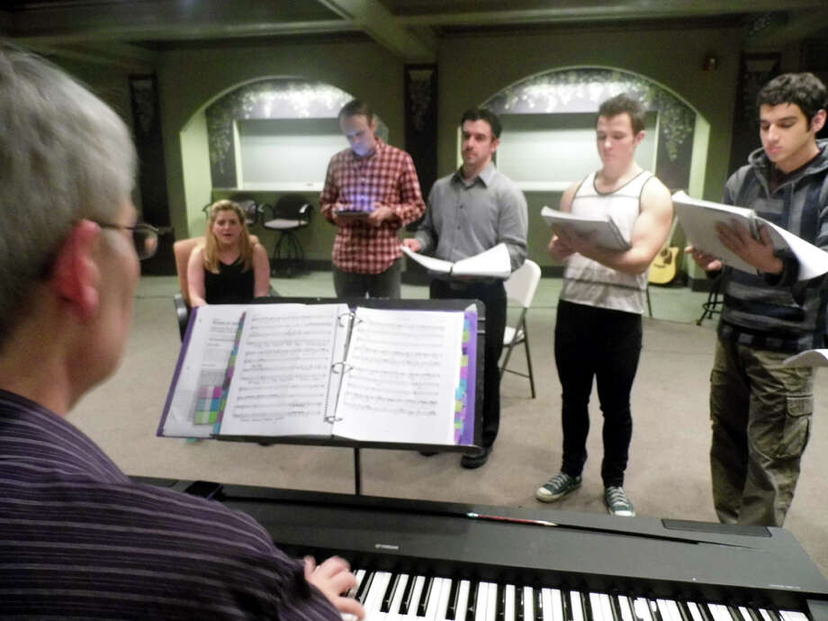"The cast of the Bridgeport Theatre Company's production of ""Next to Normal"" in a recent music rehearsal for the performances that will begin Friday, Jan. 25 at the Downtown Cabaret Theatre in Bridgeport. Photo: Contributed Photo"