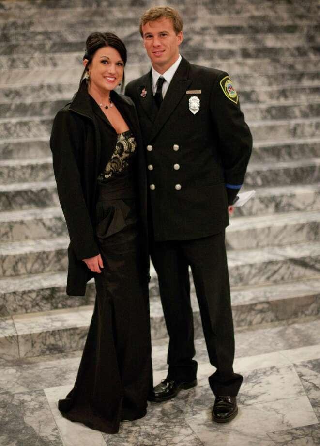 Melissa Lancaster and Bellingham firefighter Steve Dwyer are shown in the Rotunda. Photo: JOSHUA TRUJILLO, SEATTLEPI.COM / SEATTLEPI.COM