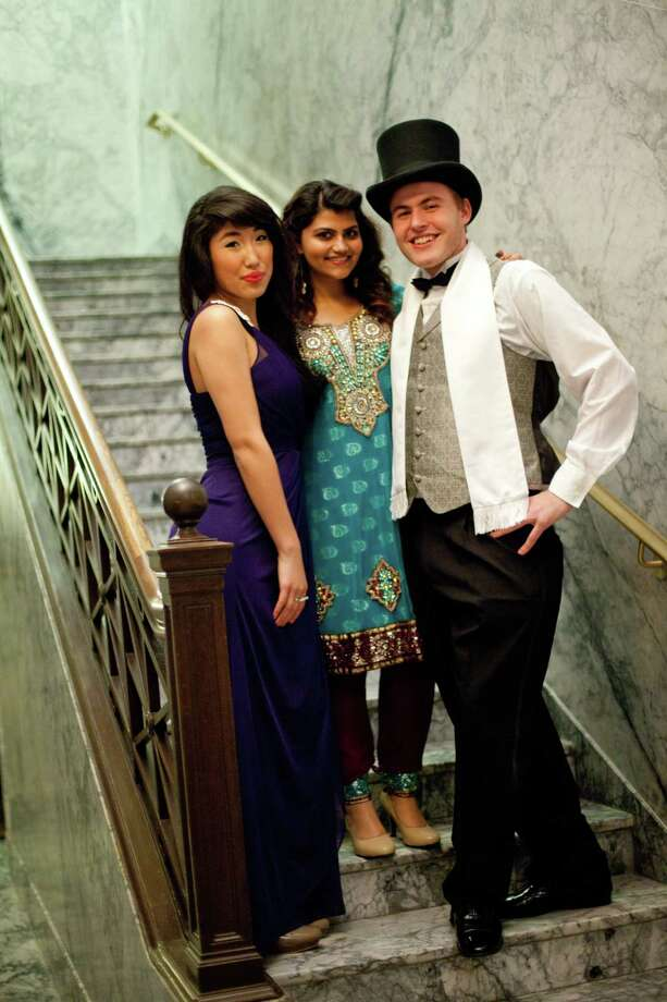 Uuriintuya Ganjargal, Maju Qureshi and Evan Briggs are shown coming down a staircase in the Capitol Building. Photo: JOSHUA TRUJILLO, SEATTLEPI.COM / SEATTLEPI.COM