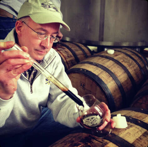 "Brewmaster Phil Markowski of Two Road's Brewery, also known as ""The Wizard,"" tests his most recent concoction: Igor's Dream Rye Russian Imperial Stout. Two Roads, in Stratford, is one of the many craft breweries that have opened in Connecticut. Photo: Contributed Photo"