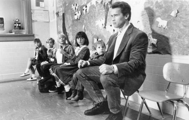 11. KINDERGARTEN COP (1990): I think this is the best of his straight comedies, unless you want to count Pumping Iron. Working with little kids seemed to make him comfortable. Penelope Ann Miller is tied with Jamie Lee Curtis as his least annoying love interest. Photo: Universal Pictures / ONLINE_YES