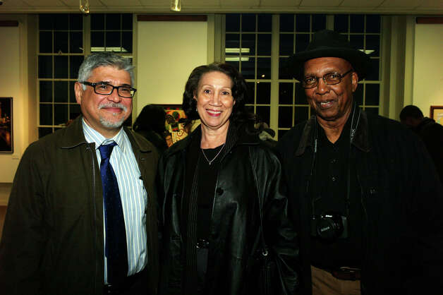 "6. ""Remember the Harlem Renaissance"" opening reception: Curator Roland Mazuca (from left) and Levorn and Paul Hurd also attend the  reception.
