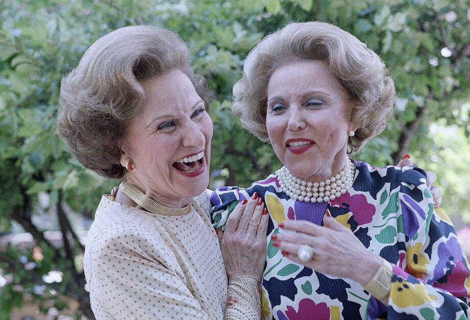 "FILE — Pauline Phillips, left, known as Abigail Van Buren for her advice column, ""Dear Abby,"" and Esther Pauline ""Eppie"" Lederer, right, known by the pen name, Ann Landers, share a light moment after arriving in Sioux City to attend their 50th high school reunion in 1986. Ann Landers died in 2002. Photo: John Gaps III, ASSOCIATED PRESS / AP1986"