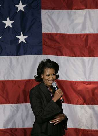 Michelle Obama, wife of Democratic presidential hopeful and US Senator Barack Obama, D-IL, introduces her husband at a fundraiser 09 March 2007 in New York.  Photo: Stan Honda, AFP/Getty Images