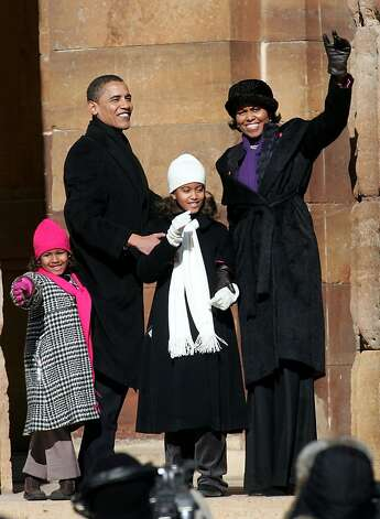 Senator Barack Obama (D-IL) (2nd-L) his daughters Sasha (L) and Malia (C) and his wife Michelle (R) wave to a crowd gathered on the lawn of the old State Capital Building February 10, 2007 in Springfield, Illinois.  Photo: Scott Olson, Getty Images