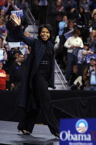 Michelle Obama takes the stage prior to her husband Democratic presidential hopeful Sen. Barack Obama (D-IL) and talk show host Oprah Winfrey December 9, 2007 in Manchester, New Hampshire.  Photo: Darren McCollester, Getty Images