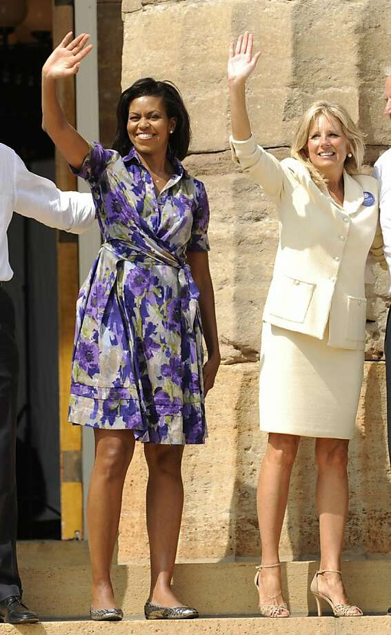 US Democratic presidential candidate Illinois Senator Barack Obama's wife Michelle (L) and running mate Delaware Senator Joe Biden's wife Jill wave at a rally in Springfield, Illinois, on August 23, 2008. Photo: Emmanuel Dunand, AFP/Getty Images