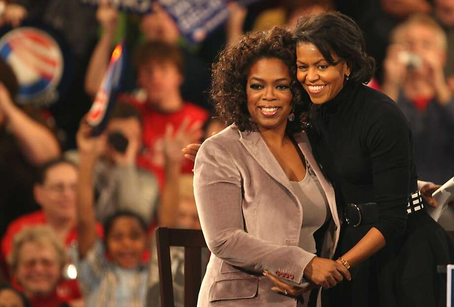 Talk show host Oprah Winfrey (L) and Michelle Obama embrace at a rally for her husband Democratic presidential hopeful Sen. Barack Obama (D-IL)  December 8, 2007 in Des Moines, Iowa.  Photo: Scott Olson, Getty Images