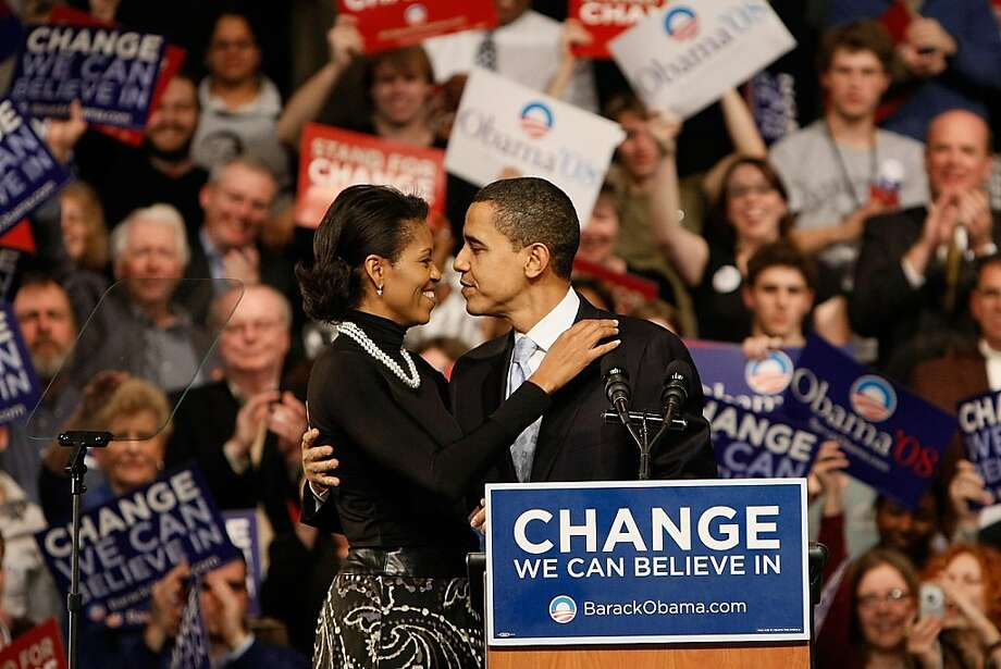 Democratic presidential hopeful Sen. Barack Obama (D-IL) hugs his wife Michelle Obama after his speech at a primary night rally in the gymnasium at the Nashua South High School on January 8, 2008 in Nashua, New Hampshire. Photo: Win McNamee, Getty Images