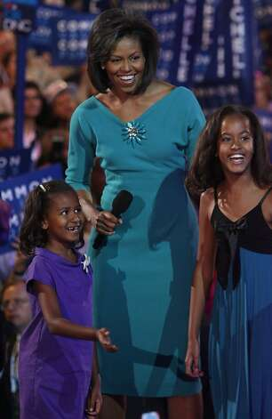 Michelle Obama (C), wife of presumptive Democratic nominee U.S. Sen. Barack Obama (D-IL), stands with her daughters Sasha (L)  and Malia during day one of the Democratic National Convention (DNC) at the Pepsi Center August 25, 2008 in Denver, Colorado.  Photo: John Moore, Getty Images