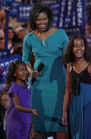 Michelle Obama (C), wife of presumptive Democratic nominee U.S. Sen. Barack Obama (D-IL), stands wit