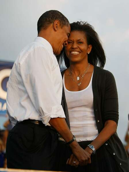 Democratic presidential nominee Barack Obama stands with his wife Michelle Obama during a campaign r