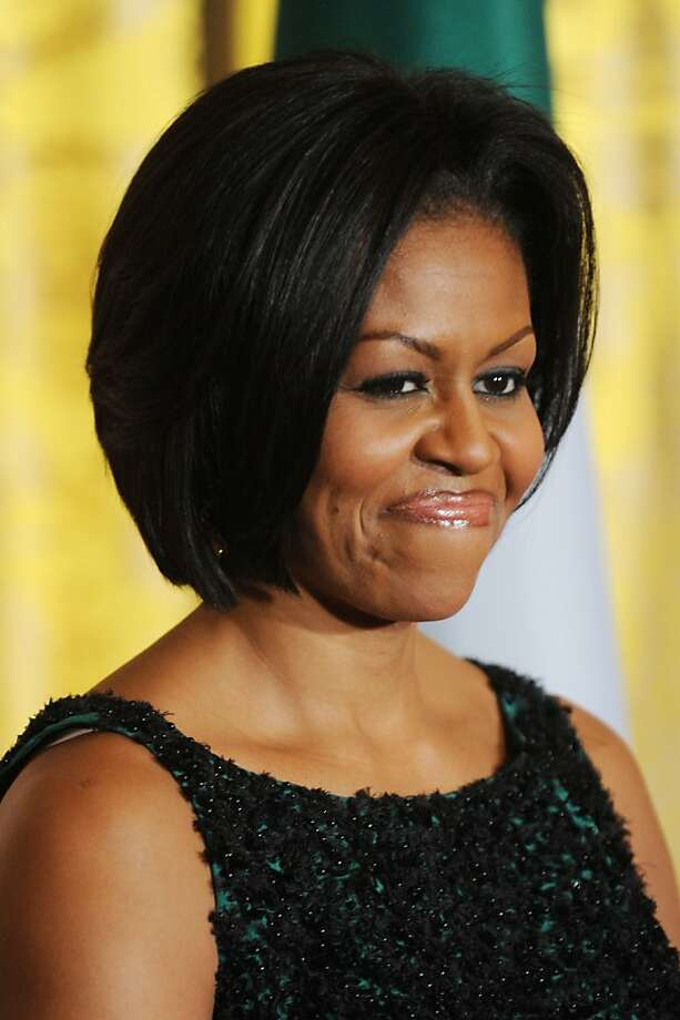 First lady Michelle Obama attends the annual St. Patrick's Day Reception in the East Room of the White House, March 17, 2010 in Washington, DC. U.S. President Barack Obama and Prime Minister of Ireland Brian Cowen delivered remarks and participated in a traditional shamrock ceremony. Photo: Pool, Getty Images