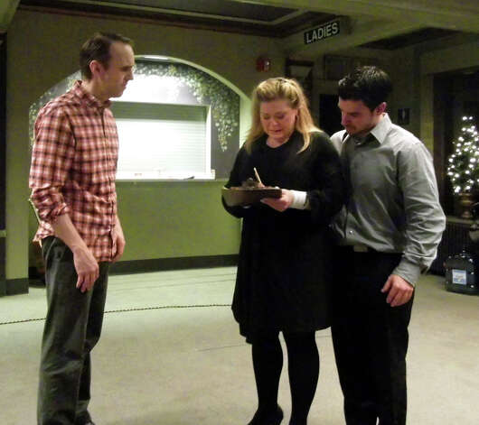 "Eli Newsom, Melinda Zupaniotis and Tony Leone (left to right) rehearse a scene from the Bridgeport Theatre Company production of ""Next to Normal"" opening Jan. 25 at the Downtown Cabaret Theatre in Bridgeport. Photo: Contributed Photo"