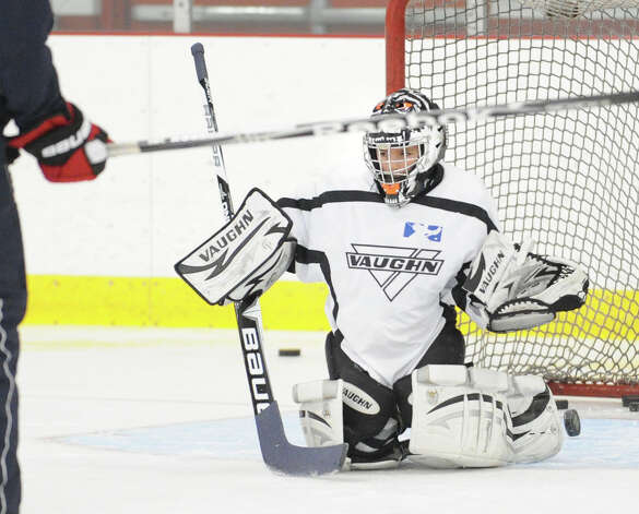 Squirt A hockey goalie Tristan Fattedad,9, makes a stop during practice at Dorothy Hamill Rink in Byram, Wednesday night, Jan. 16, 2013. A new multi-ice surface arena is proposed for Rye Brook, N.Y., right on the town line with Greenwich. Photo: Bob Luckey / Greenwich Time