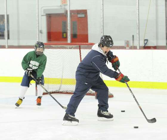 Squirt B hockey coach Brett Farson, right, leads practice at Dorothy Hamill Rink in Byram, Wednesday night, Jan. 16, 2013. Farson is also the Greenwich High School girls varsity ice hockey coach. A new multi-ice surface arena is proposed for Rye Brook, N.Y., right on the town line with Greenwich. Photo: Bob Luckey / Greenwich Time