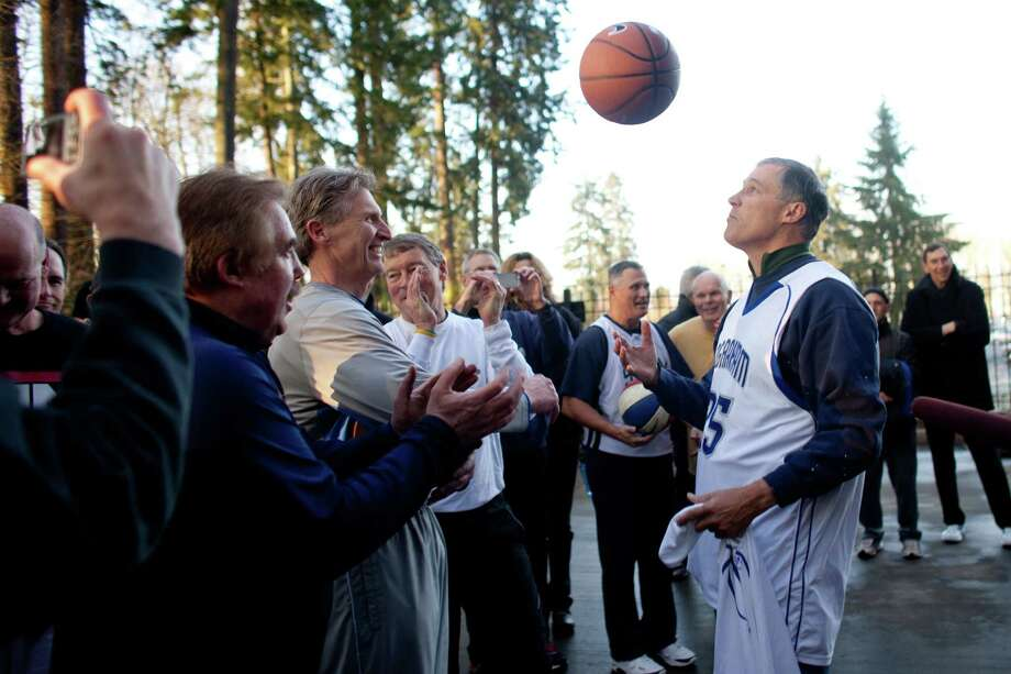 Governor Jay Inslee prepares to shoot some hoops at the Governor's Mansion after he was inaugurated on Wednesday, January 16, 2013 in the rotunda of the State Capitol building. Photo: JOSHUA TRUJILLO, SEATTLEPI.COM / SEATTLEPI.COM