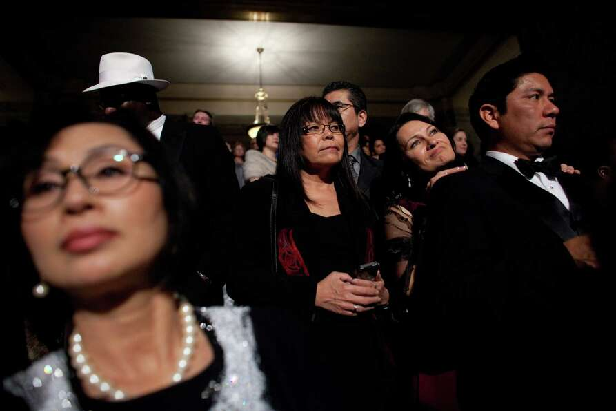 People wait for the presentation of Governor Jay Inslee during the Governor's Ball on Wednesday, Jan